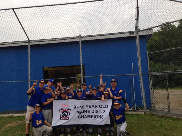 Members of the Hermon Little League all-star baseball team celebrate with their championship banner after beating Bronco Little League of Hampden 6-3 in the District 3 title game for ages 9-10. Hermon advanced to the state tourney will play Friday at Auburn Suburban.