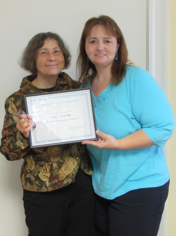 Christine B. Hastedt  Accepting Outstanding Community Dedication Award from MAIN Leader Kandie Desell