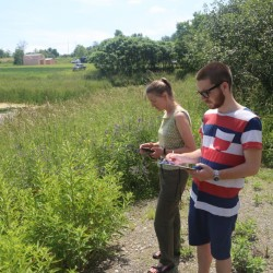 Jonah Gula '15 and Assistant Professor Cheryl Frederick conducting research on the Unity College campus in June.