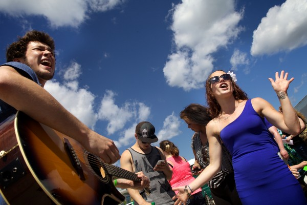 Zach Silk (left) and Kayla Bannister belt out a song while waiting in line to audition for American Idol with hundreds of people on Wednesday on the Maine State Pier in Portland.