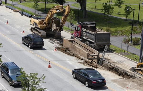 Cars drive by construction Tuesday near the intersection of Main Street and Buck Street in Bangor.