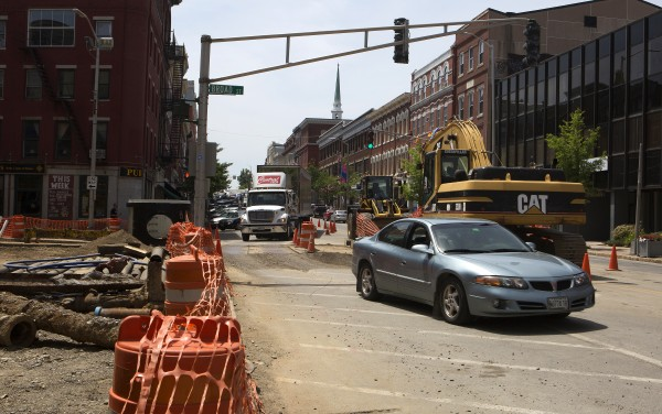 Cars navigate the construction near the intersection of Main and Broad streets Tuesday in Bangor.
