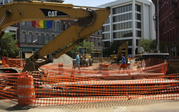 Pedestrians navigate the construction near the intersection of Main Street and Broad streets Tuesday in Bangor.