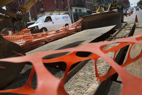 A car navigates the construction near the intersection of Main Street and Broad streets Tuesday in Bangor.