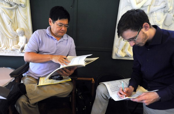 Music Director Michael Jinbo (left) goes over the score with second year conducting student Jonathan Moore, 25, of Dallas, Texas during a break in the rehearsal at the Pierre Monteux School for Conductors and Orchestra Musicians.  Jinbo first came here as a student in 1983, and he became the third Music Director after Charles Bruke's death 19 years ago. The school was founded in 1943 by French conductor Pierre Monteux and his wife, Doris Monteux.