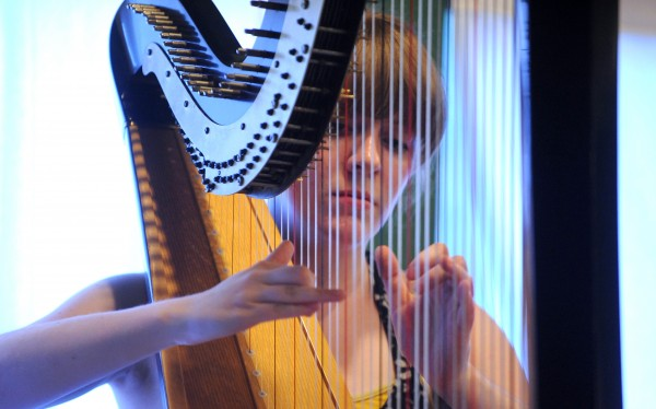 Harpist Grace Cross during rehearsal at the Pierre Monteux School for Conductors and Orchestra Musicians. Cross is originally from San Francisco, California, now she attends the Cleveland Institute of Music and this is her first year of taking part in the Monteux School's six-week-long course.