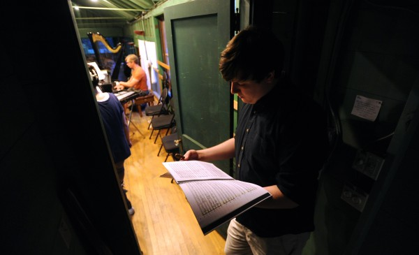 Jordan Alfredson, 22, of Atlanta, Georgia, goes over the score before his turn to take the podium to conduct at the Pierre Monteux School for Conductors and Orchestra Musicians.  Alfredson is one of the 15 conducting students this year and when not on the podium, he plays bassoon in the orchestra.
