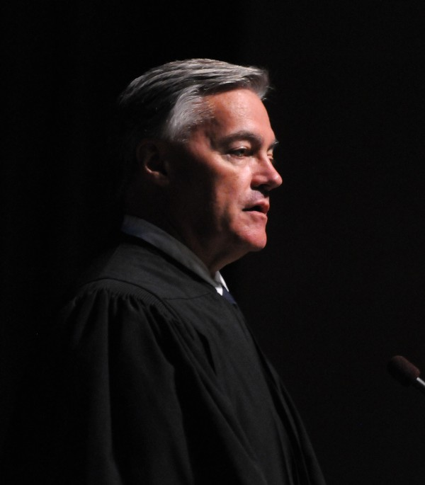 Chief U.S. District Judge John A. Woodcock speaks during a Naturalization Ceremony at the Gracie Theater at Husson University in Bangor on Thursday.