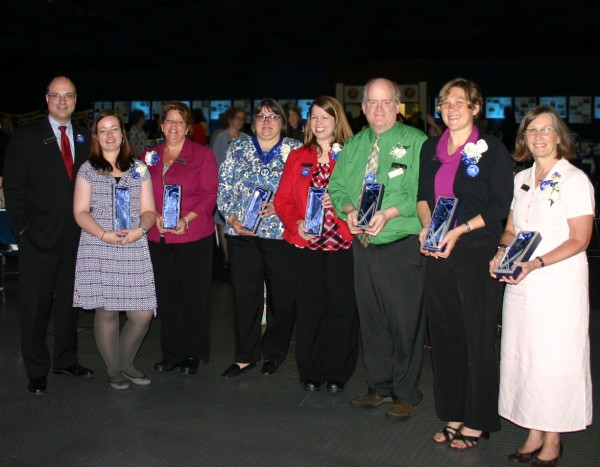 Greg Dufour, president and chief executive officer of Camden National Bank, congratulates award winners at this year's Stakeholder Appreciation Event held on June 18 at the Augusta Civic Center. Pictured left to right: Dufour, Penny Johnson, Tena Wallace, Cindy Dines, Angie Snow, Danny Jackson, Betsy Maguire and Susan Van Allen.