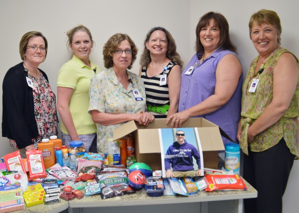 "Members of the TAMC Team recently donated a ""goodie"" box to support troops in Afghanistan.  Participating in the project were, from left:  Michelle Boucher, compliance officer; Courtney Lovely, manager; Susan Forbes, RN, patient safety officer; Maureen Jordan, administrative support; Pam McClung, core measures specialist; and Sheila Bragdon, infection prevention tech."