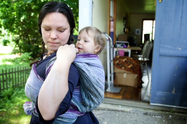 Kristi Hayes-Devlin carries her son Xavier, 2, on her back using one of the slings she sells under the name brand Wrapsody out of her Berwick home on Tuesday, July 8.