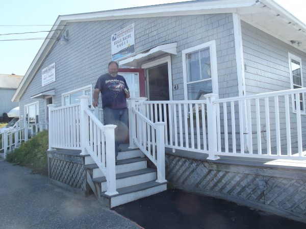 Maurice Alley leaves the Beals post office after retrieving his mail on Monday. The Postal Services does not provide roadside mailbox delivery on the island; residents must go to the post office to pick up their mail.
