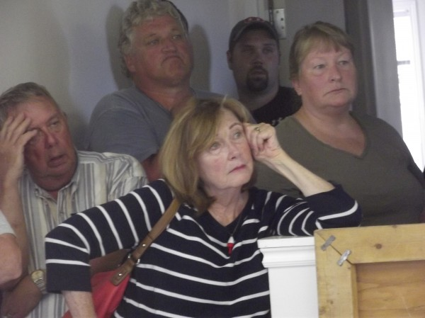 Residents of Beals listen to a Postal Service official at the town office on Monday. The Postal Service is planning on reducing hours at the island's post office.