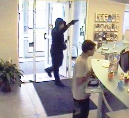 A screenshot of security camera footage shows a person allegedly robbing Five County Credit Union in Lisbon on Thursday.