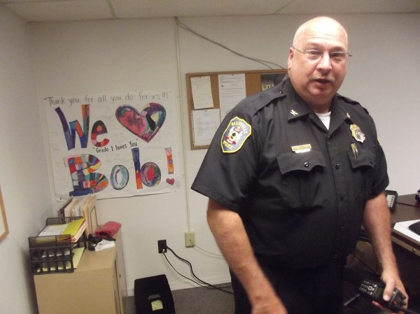 Baileyville Police Chief Bob Fitzsimmons talks in his office. Poster at left, emblazoned with 'Grade 1 loves you,' was from students at Woodland Elementary School.