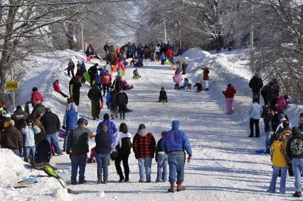 Baileyville Police Chief Bob Fitzsimmons organized a day of sledding on this hill in town this past winter. Public works employees donated their time to temporarily cover a portion of the street with snow.
