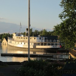 The Kate rests in her berth at East Cove in Greenville on a soft summer evening.