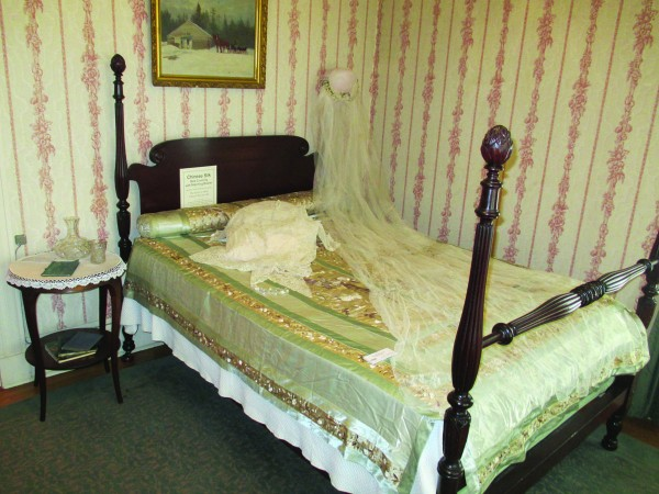 Master bedroom at Eveleth-Crafts-Sheridan home with items chosen by docents.