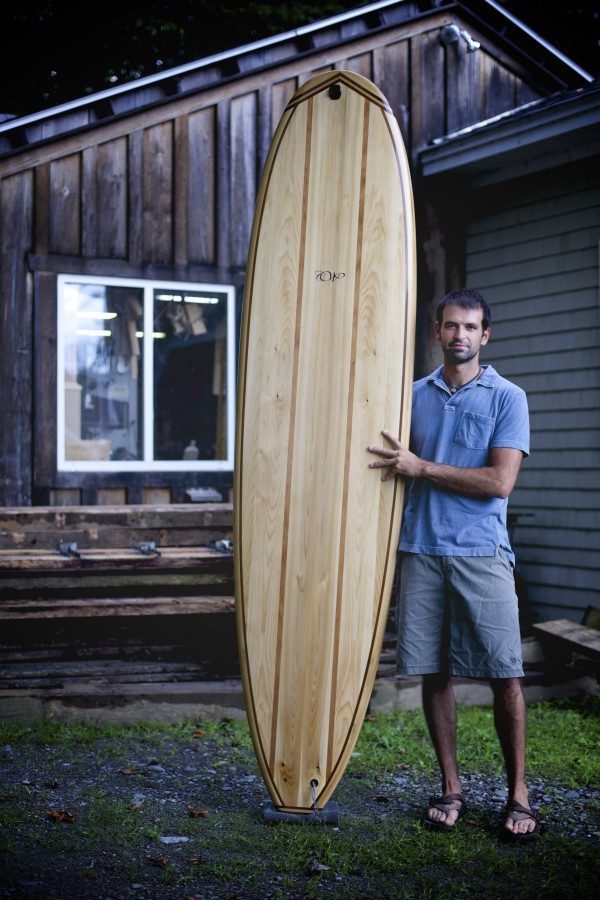 By day Luke Cushman is a carpenter usually working long hours on MDI. By night, Cushman builds cedar surfboards in a shop adjacent to his home on Pushaw Lake.