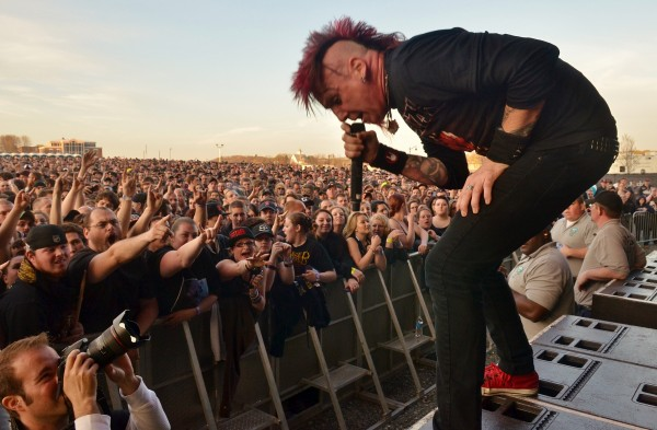 The crowd surges close to Hellyeah frontman Chad Gray in the Rise Above Fest at the Waterfront Pavilion in Bangor on May 10. The city logged 124 noise complaints during the daylong music festival.
