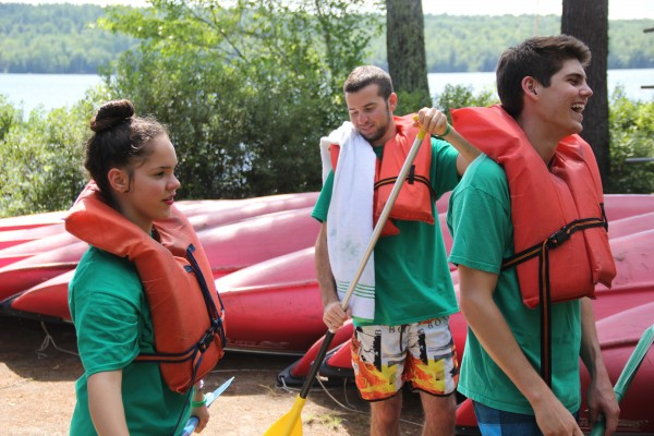 Ophir and Dean of Israel and Oliver of New York receive a lesson in canoeing at the Seeds of Peace camp.