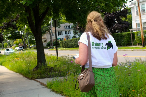 Lisa Smith of Falmouth, a volunteer for Mainers for Fair Bear Hunting, travels door to door in Portland on Aug. 10, 2014, to encourage voters to vote &quotyes&quot on Question 1, a referendum to ban the use of bait, hounds and traps in black bear hunting in Maine, which is appear on the Nov. 14 ballot.
