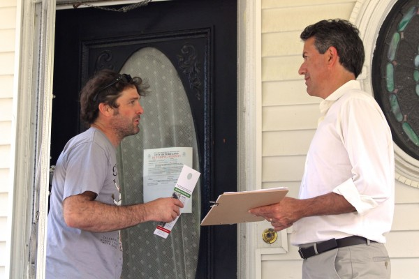 Wayne Pacelle, president of the Humane Society of the United States (right) encourages Travis Bullard of Portland to vote &quotyes&quot on Question 1 on the November ballot while doing door to door calls in Portland on Aug. 10, 2014 with volunteers for Mainers for Fair Bear Hunting. Question 1 is a referendum to ban the use of bait, hounds and traps in black bear hunting in Maine.