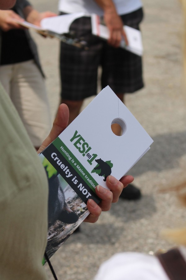 Volunteers for Mainers for Fair Bear Hunting went door to door in Portland on Aug. 10, 2014, handing out flyers encouraging residents to vote &quotyes&quot on Question 1, a referendum to ban the use of bait, hounds and traps in black bear hunting in Maine, which will appear on the Nov. 14 ballot.