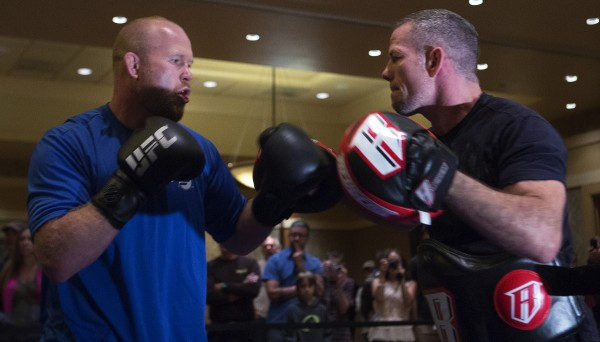 Maine native Tim Boetsch (left) hits the mitts during open workouts at Hollywood Casino in Bangor on Thursday in preparation for UFC Fight Night.