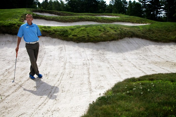 Doug Van Wickler stands in one of the four bunkers that stand between the tee and the green on hole number four at The Woodlands Club in Falmouth. The sand traps are known locally as the &quotcoffins.&quot
