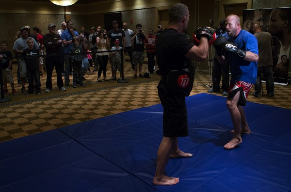 Maine native Tim Boetsch (right) spars during open workouts at Hollywood Casino in Bangor Thursday in preparation for UFC Fight Night.