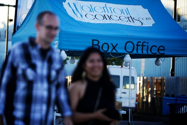 Concert goers pass the makeshift box office at the Maine State Pier before the Alanis Morissette show on Saturday night in Portland.
