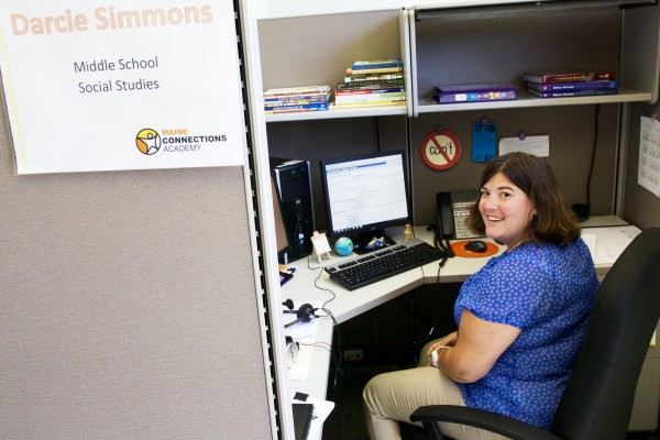Middle school social studies teacher Darcie Simmons sits at her desk at Maine Connections Academy, a virtual charter school, in South Portland on Friday.