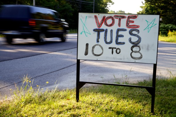 A sign in Arrowsic  urges voters to exercise their right to vote in special Maine Senate District 19 election in August 2013.