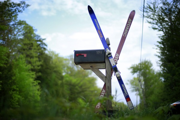 An old pair of skis marks the spot of a mailbox in Belgrade, Maine.