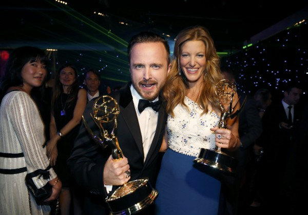 AMC's &quotBreaking Bad&quot star Aaron Paul with his Outstanding Supporting Actor in a Drama Series award and Anna Gunn with her Outstanding Supporting Actress in a Drama Series award attend the Governors Ball for the 66th Primetime Emmy Awards in Los Angeles, August 25, 2014.