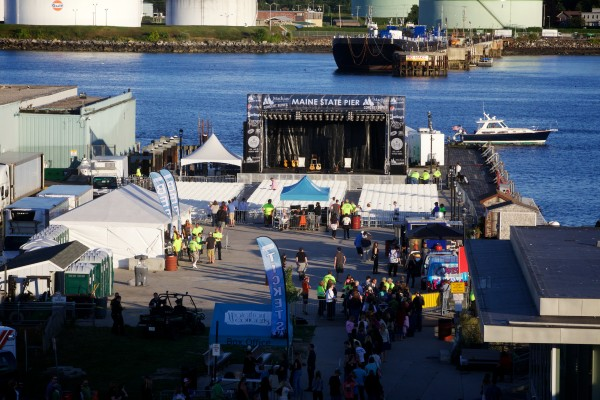 Concert goers start to fill the the Maine State Pier before the Alanis Morissette show on Saturday in Portland.