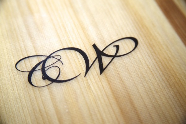 Luke Cushman's logo for his company Cushman Woodworking &quotCW&quot is laid on a wooden surfboard he constructed.