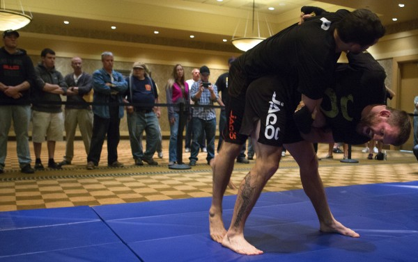 Ryan Bader (right) works on his takedowns during open workouts at Hollywood Casino in Bangor Thursday in preparation for UFC Fight Night.