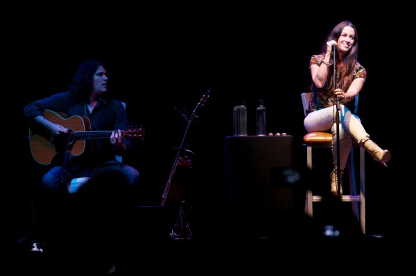 Alanis Morissette, and one of two acoustic guitar players, perform Saturday at the Maine State Pier in Portland.