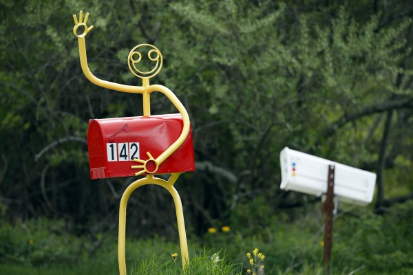 A mailbox figure waves to passing motorists in New Gloucester, Maine.