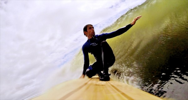 Luke Cushman surfs a hollow-core wooden surfboard that he built at his home in Old Town.
