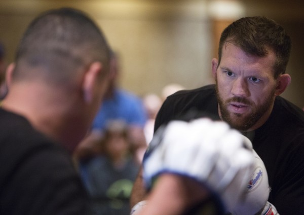 Ryan Bader (right) hits the mitts during open workouts at Hollywood Casino in Bangor on Thursday in preparation for UFC Fight Night.