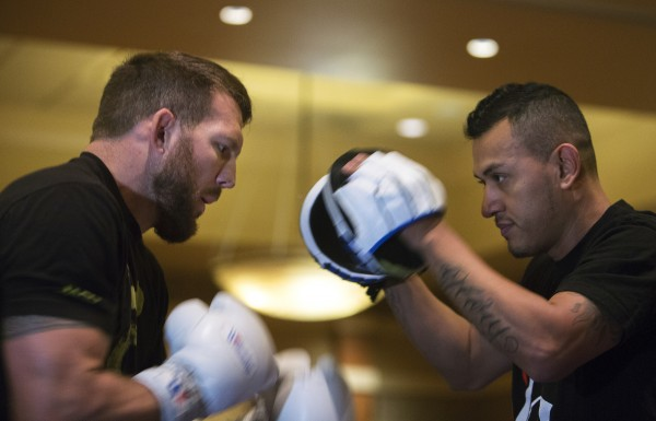 Ryan Bader (left) hits the mitts during open workouts at Hollywood Casino in Bangor on Thursday in preparation for UFC Fight Night.