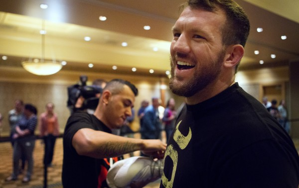 Ryan Bader (right) laughs while getting help with his gloves during open workouts at Hollywood Casino in Bangor on Thursday in preparation for UFC Fight Night.