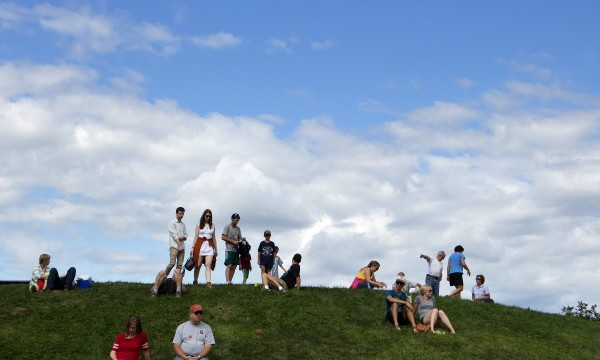 People relax on a hill while enjoying the 2014 American Folk Fest on Aug. 23.