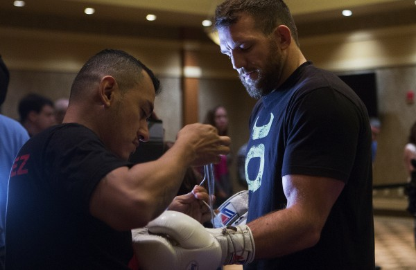 Ryan Bader (right) gets help with his gloves during open workouts at Hollywood Casino in Bangor on Thursday in preparation for UFC Fight Night.