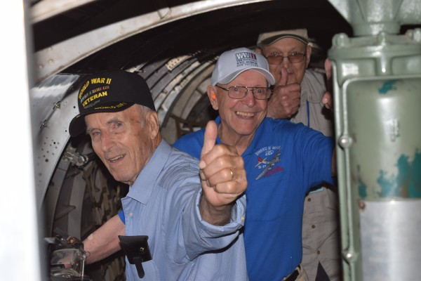 WWII veterans Edmond Theriault (left), Alberie Nadeau (center) and Roland Dumond give the thumbs up as they board the Sentimental Journey B-17 bomber in Frenchville on Thursday.