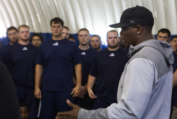 Ovince Saint Preux speaks to University of Maine football players during a meet-and-greet at the campus in Orono Thursday.