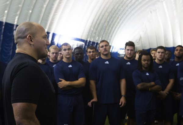 Shawn Jordan speaks to University of Maine football players during a meet-and-greet at the campus in Orono on Thursday.